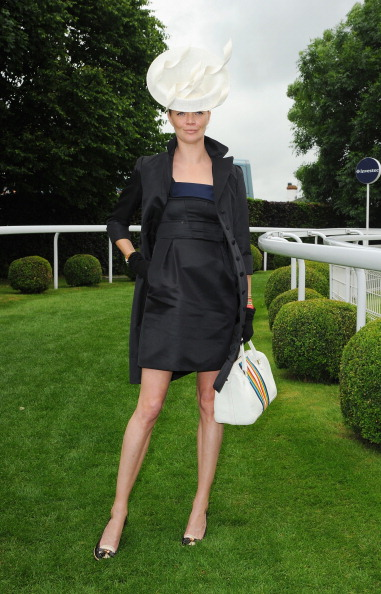 Jodie Kidd wears Suzannah Dress and Coat with Philip Treacy Millinery