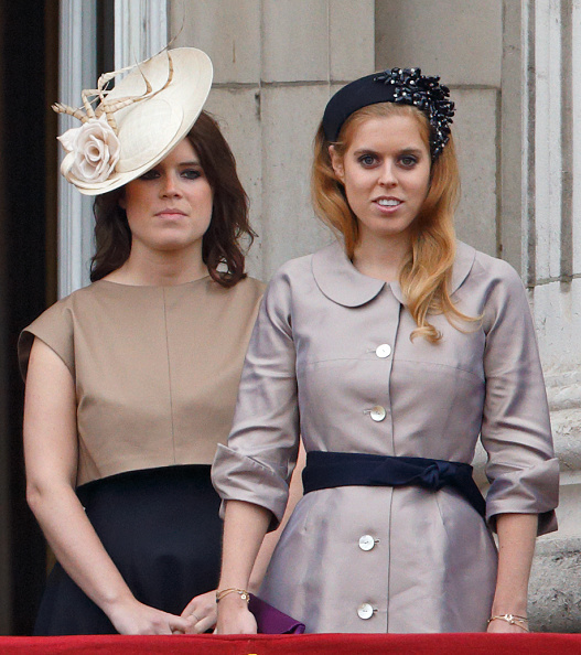 LONDON, UNITED KINGDOM - JUNE 13: (EMBARGOED FOR PUBLICATION IN UK NEWSPAPERS UNTIL 48 HOURS AFTER CREATE DATE AND TIME) Princess Eugenie and Princess Beatrice stand on the balcony of Buckingham Palace during Trooping the Colour on June 13, 2015 in London, England. The ceremony is Queen Elizabeth II's annual birthday parade and dates back to the time of Charles II in the 17th Century, when the Colours of a regiment were used as a rallying point in battle. (Photo by Max Mumby/Indigo/Getty Images)