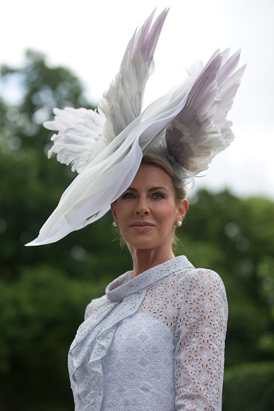 A racegoer poses for photographers on the first day on the first day of the Royal Ascot horse racing meet, in Ascot, west of London, on June 14, 2016.  / AFP / JUSTIN TALLIS        (Photo credit should read JUSTIN TALLIS/AFP/Getty Images) Belinda Strudwick wears bespoke Suzannah with Edwina Ibbotson millinery